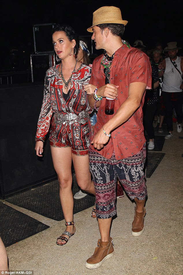 Let's coordinate: Katy Perry and Orlando Bloom seem keen to prove they are a perfect match while partying at Coachella festival in California on Sunday
