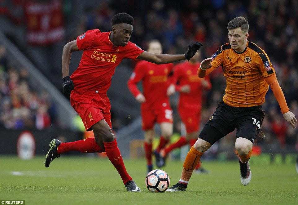 Liverpool youngster Ejaria looks to take the ball forwards as he wards off the attentions of Wolves' Lee Evans