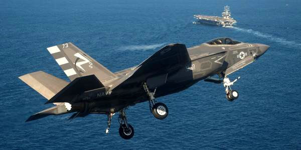 The F-35C Lightning II approaches the USS Nimitz...prior to becoming the first Joint Strike Fighter jet to make an arrested landing aboard an aircraft carrier, on November 3, 2014.