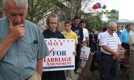 People pray supporting a constitutional ban on gay marriage in Raleigh, North Carolina