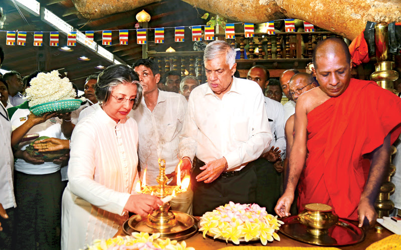 Prime Minister Ranil Wickremesinghe accompanied by his wife Professor Maithree Wickramasinghe, visited the Gangaramaya Temple in Colombo soon after a No-Confidence motion brought by the Joint Opposition against him was comfortably defeated in Parliament. Here, the Premier and his wife participating in religious observances . Picture by Rukmal Gamage