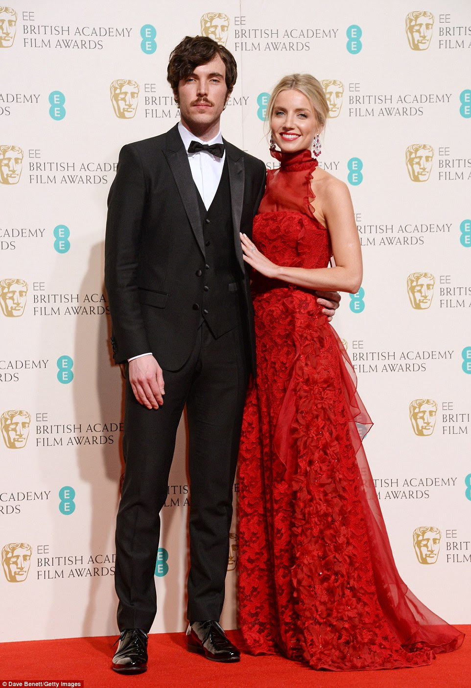 Storming the awards: Anabelle walked along the red carpet with Cemetery Junction actorTom Hughes, who she presented an award with later in the evening