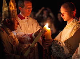 Pope Benedict XVI lights the Pashcal Candle at the Vatican's 2011 Easter Vigil. CNS Photo/Paul Haring