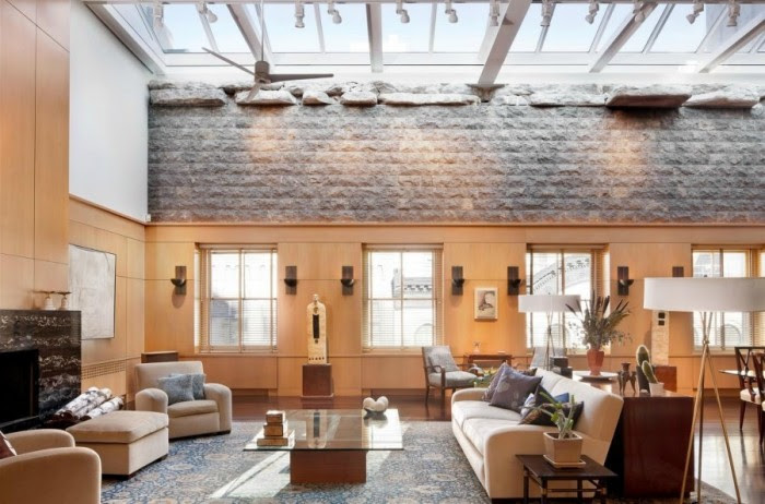 A four-bedroom penthouse in TriBeCa boasts ceilings of skylights expanding the full width and length of the open concept space. As a result, natural light floods the space bouncing throughout the room.