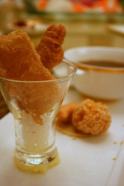 Crispy glutinous rice cake and snacks, with bowl of azuki bean soup