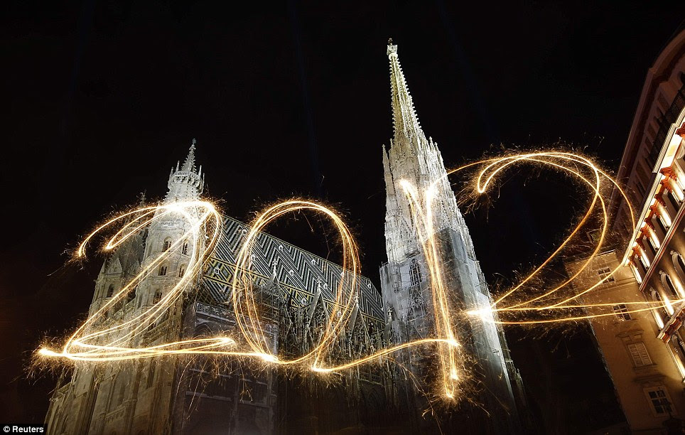 VIENNA: The number 2012 is written with sparklers during a long exposure in front of St Stephen's Cathedral during New Year's Eve celebrations