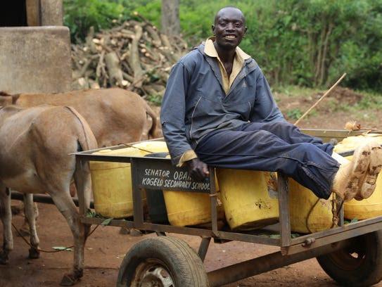 Willys Onyango, 28, a handcart pusher works in Kogelo