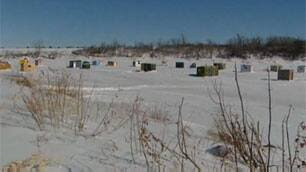 A village of ice fishing shacks sets up every winter along the frozen Red River.