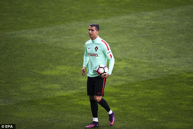 Ronaldo holds a ball during Saturday's training session as they prepared for Latvia clash