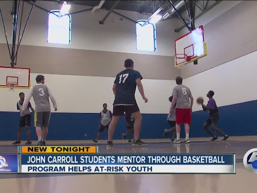 John Carroll students mentor at-risk youth with basketball and pizza