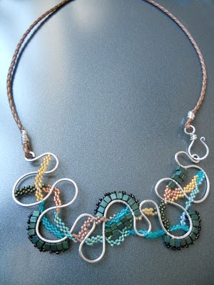 I am truly stunned by the kinetic nature of this necklace. The wire and the bead weaving give this so much movement! Created by Miss Bobbie Rafferty inspired by the Meandering Mississippi palette