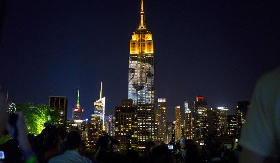 "Large images of endangered species are projected on the south facade of The Empire State Building, Saturday, Aug. 1, 2015, in New York. The large scale projections are in part inspired by and produced by the filmmakers of an upcoming documentary called ""Racing Extinction.""  (AP Photo/Craig Ruttle)"