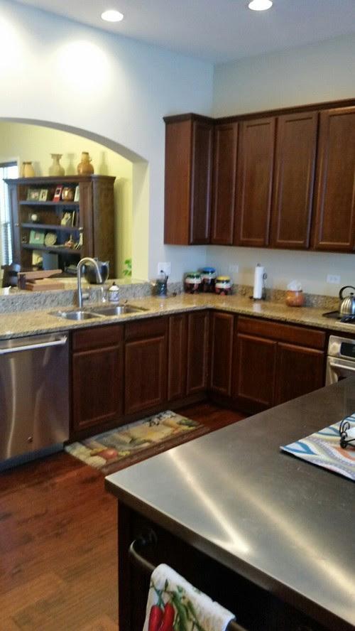 I have a kitchen with dark cherry cabinets and dark cherry ...