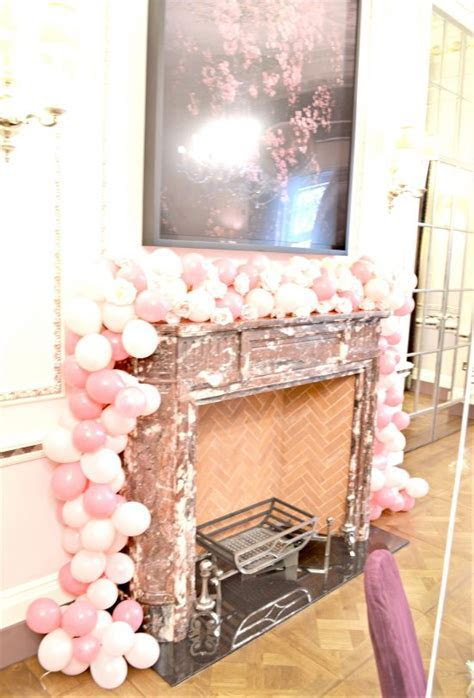 Flower Arrangements, Balloon Garland and Cake at The