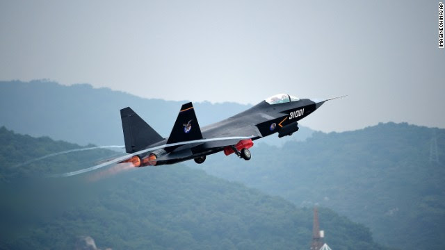 A Chinese J-31 stealth fighter jet takes off for a demonstration flight on November 9, in Zhuhai, China. China's air force is set to debut its newest fighter jet this week at <a href='http://edition.cnn.com/2014/11/10/world/asia/china-air-show/index.html'>Airshow China</a>. The air show, held once every two years, aims to showcase the country's aviation power and this year coincides with a meeting in Beijing of leaders of the Asia-Pacific Economic Cooperation forum, including U.S. President Barack Obama.