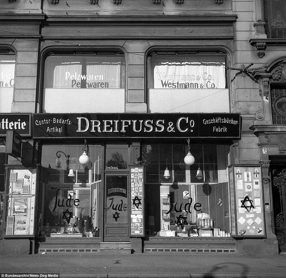 This Jewish shop was vandalised in                               Berlin in the aftermath of Kristallnacht -                               the night of the broken glass - in                               November 1938. The Nazi party's own police                               force, the SA was responsible for the                               outbreak of violence on November 9 and 10.                               As well as targeting Jewish stores and                               offices, the SA burned more than 260                               synagogues across Germany and Austria