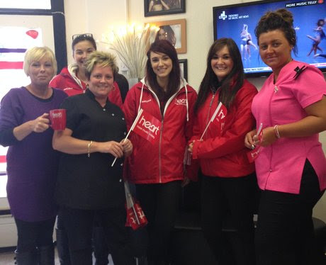 Pam, Ali and Sophie of Euphoria Hair Design grab a photo and some freebies from the Heart Angels