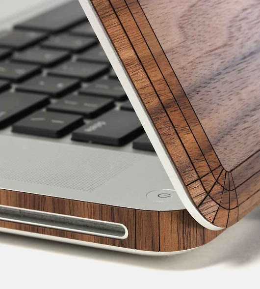 What are the benefits and drawbacks of enveloping your MacBook or Windows laptop in wood paneling?