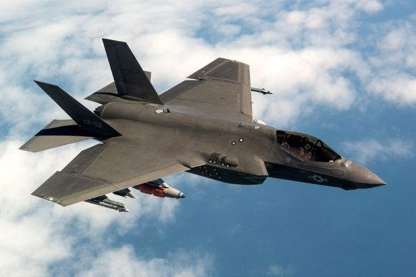 An F-35C Lightning II aircraft, designated 'CF-2', conducts the final test flight for the System Development and Demonstration (SDD) phase of the F-35 program...on April 11, 2018.