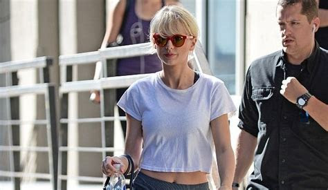 Taylor Swift Flashes Belly Button Leaving Gym in NY