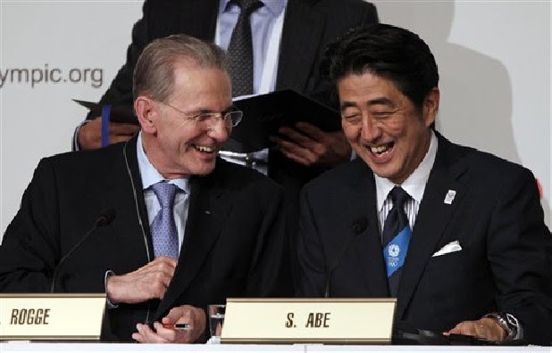 Japan's Prime Minister Shinzo Abe, right, and President of the International Olympic Committee Jacques Rogge smile after signing the Host City Contract after Tokyo was awarded the 2020 Olympic Games in Buenos Aires, Argentina, Saturday, Sept. 7, 2013.