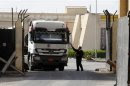 Truck loaded with building materials drives at the Rafah crossing with Egypt, in the southern Gaza Strip