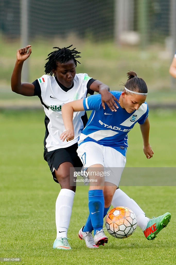 Elizabeth Addo (L) of Ferencvarosi TC challenges Edina Faradi-Szabo (R) of MTK Hungaria FC during the Women's Hungarian Jet-Sol Liga Final second leg match between MTK Hungaria FC and Ferencvarosi TC at BKV Stadium on May 23, 2016 in Budapest, Hungary.