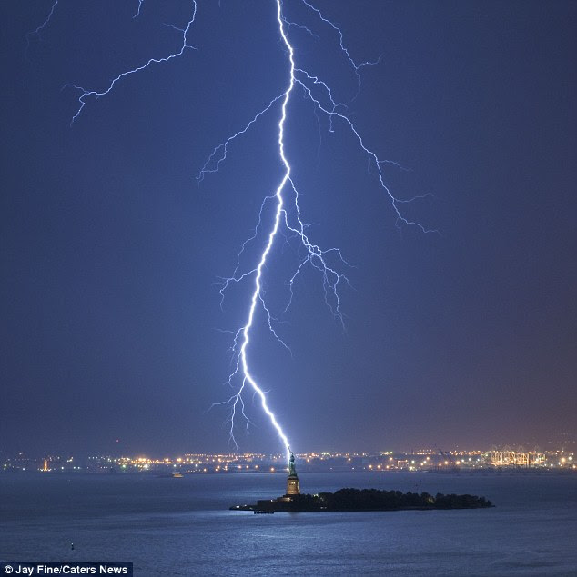 Storm: The iconic New York monument, made from copper plates, is thought to be hit by up to 600 bolts of lightning every year