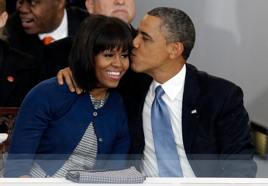 Barack gives Michelle a kiss during the inaugural parade.