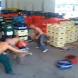 Workers Quickly Sort Crates Full of Empty Beer Bottles