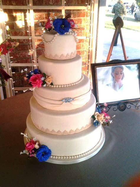 Ivory country wedding cake   Ivory fondant covered 5 tier