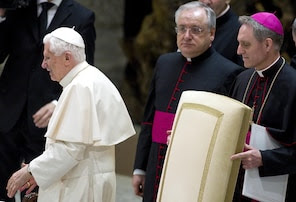 Pope Benedict XVI made his first public appearance since Monday's resignation announcement to a packed audience hall in Vatican City on Tuesday.