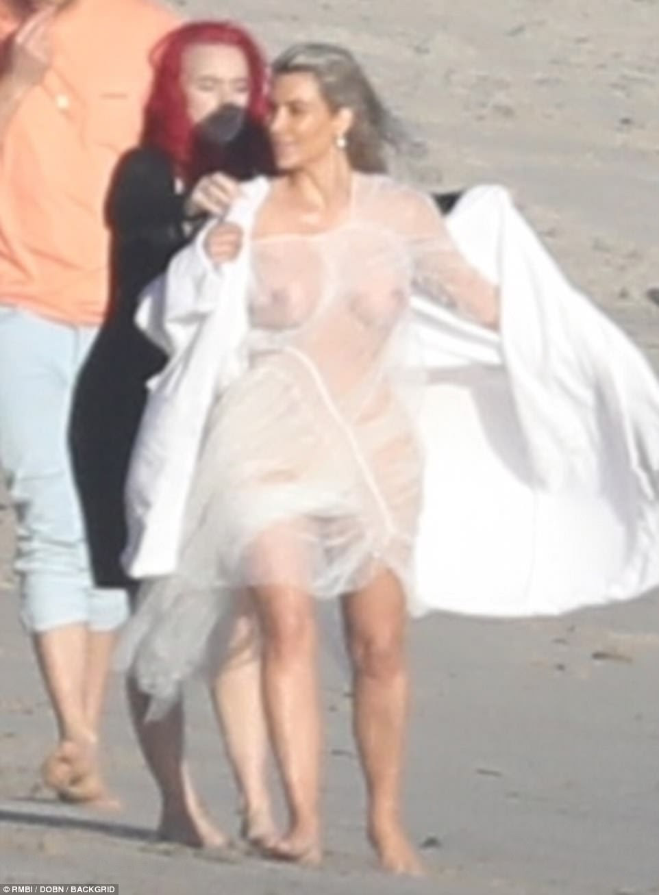 Kim Kardashian shows off her nipples in?see-through outfit for beach photoshoot (photos)