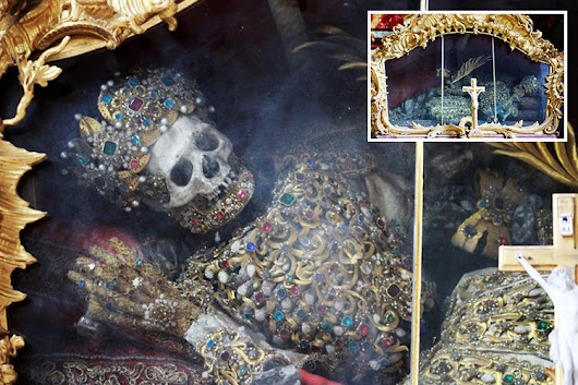 Gold and jewel-encrusted skeltons of two 2,000-year-old saints at abbey