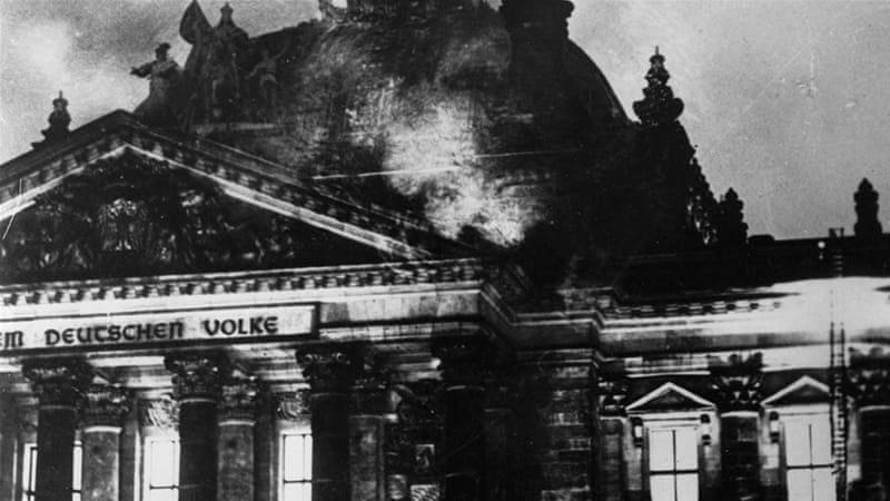 The Reichstag in flames during the Nazi ascent to power in Berlin, February 27, 1933 [Fox Photos/Getty Images]