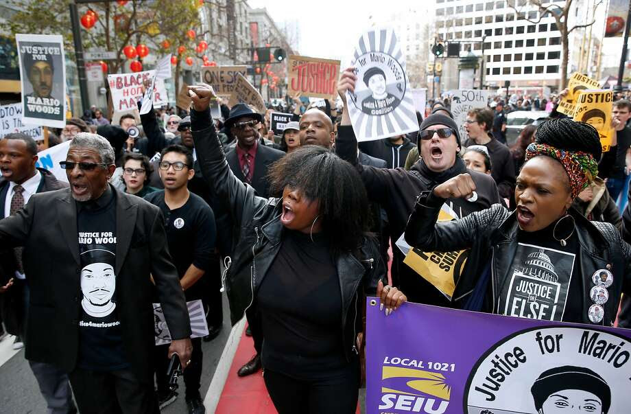 Deja (center) and Cassandra Grant (right) lead protesters demanding justice for Mario Woods, the Bayview man shot and killed by police nearly two months ago, on a march down Market Street to the site of Super Bowl City in San Francisco, Calif. on Saturday, Jan. 30, 2016. Photo: Paul Chinn, The Chronicle