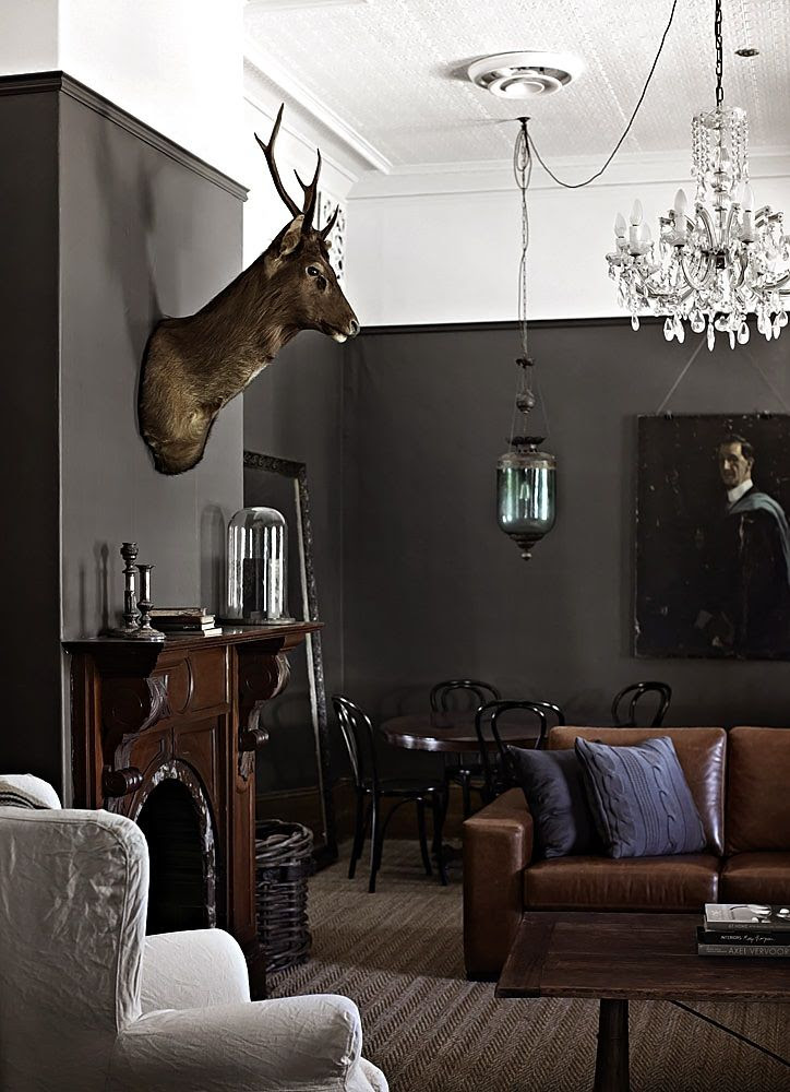 Charcoal walls and tan leather sofa!