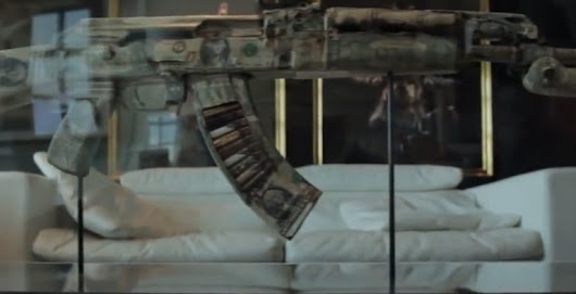 「AK-47 wrapped in dollar bills」の画像検索結果