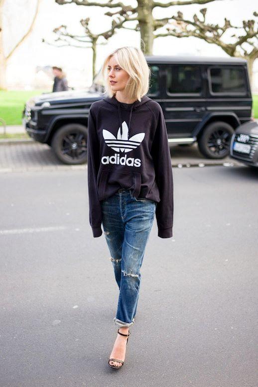 Le Fashion Blog Blogger Style Sporty Chic Athleisure Trend Black Adidas Hooded Sweatshirt Distressed Boyfriend Denim Helled Sandals With Ankle Straps Via Lisa RVD