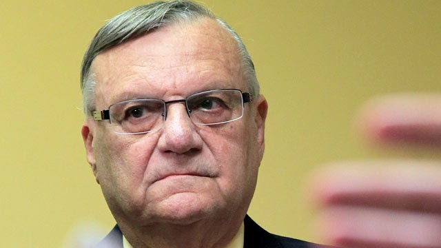PHOTO: Maricopa County Sheriff Joe Arpaio listens to one of his attorneys during a news conference, April 3, 2012, in Phoenix.