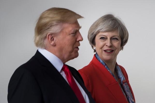 Theresa May «ne veut pas mettre Trump en... (AFP)