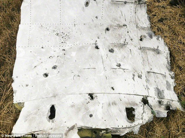Pieces of the Boeing 777 have tiny holes suggesting small pieces of shrapnel entered the aircraft externally
