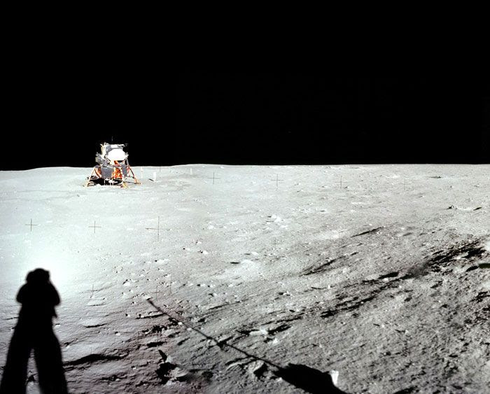 Apollo 11 astronaut Neil Armstrong, his shadow visible in the foreground, photographs the Eagle Lunar Module at Tranquility Base, on July 20, 1969.