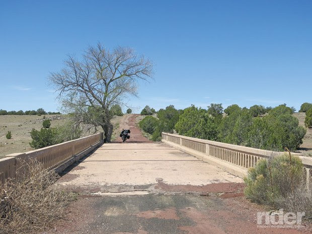That old U.S. 66 bridge, with the tree growing out of it, was built across Partridge Creek west of Ash Fork, Arizona, some 80 years ago, and is still used by locals today—though probably not approved by the authorities.