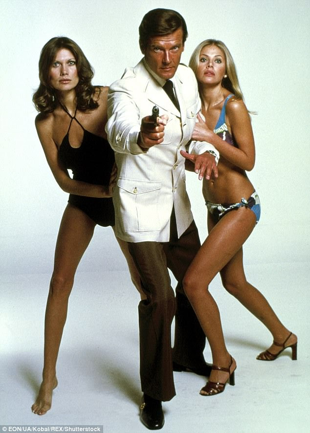Maud Adams and Britt Ekland pose with Sir Roger Moore in a publicity photo for The Man With The Golden Gun (1974)