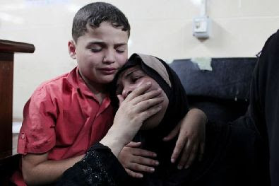 Gaza family weeps after two members were killed in a Hamas missile misfire from a concealed launcher at the Al-Shifa hospital, July 28, 2014. Ten children died and 30 people were wounded in the incident, which Hamas tried to blame on Israel.