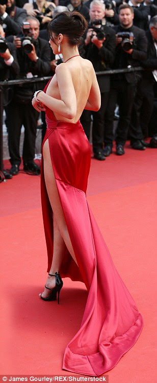 Sensational:The 19-year-old beauty stole the show in an extremely racy red gown which showed off every inch of her phenomenal frame while blatantly exhibited her choice to forego underwear during her turn at the star-studded soiree