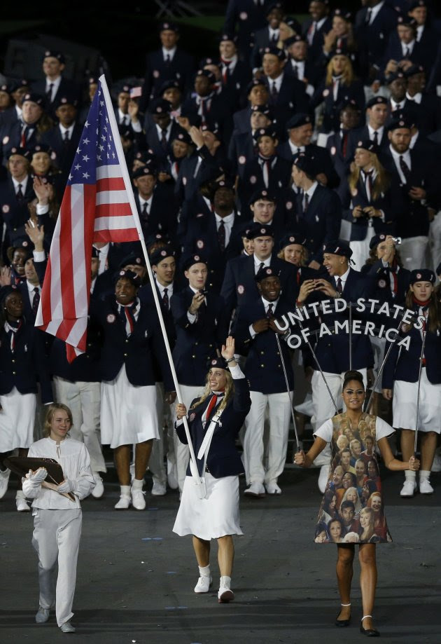 Flag bearer Mariel Zagunis of the U.S. holds the national flag as she leads the contingent in the athletes parade during the opening ceremony of the London 2012 Olympic Games at the Olympic Stadium