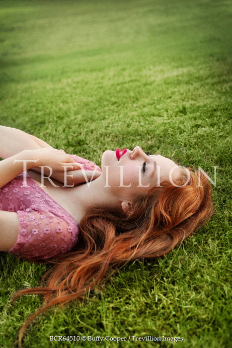 Buffy Cooper AUBURN HAIRED WOMAN LYING ON GRASS Women