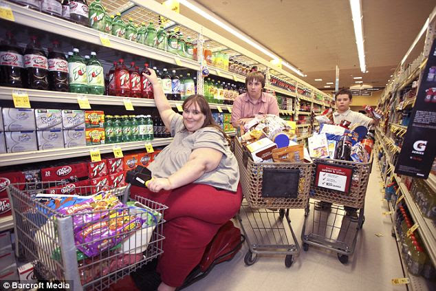 Supermarket sweep: Ms Eman spends an incredible eight hours stocking up for the month